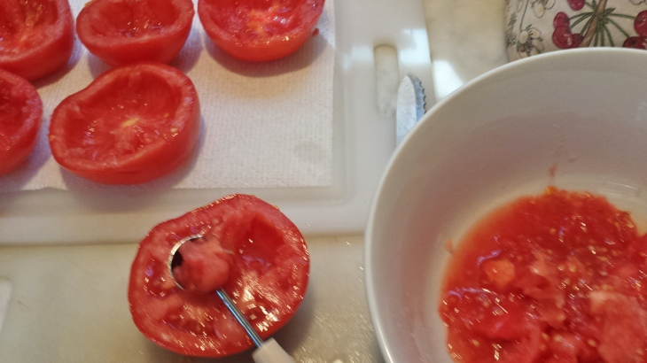 Cut tomatoes in half and scoop out pulp